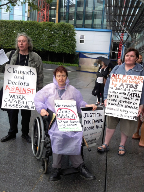 Protesters outside the ATOS headquarters in Euston point to the damage that ATOS, a sponsor of the Paralympics, has done to disabled people