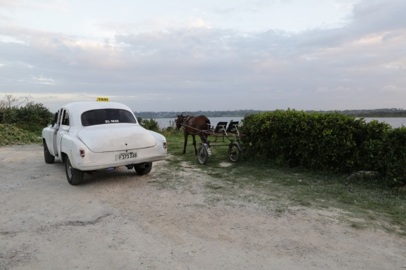 Vintage taxi at lake in Cuba, 5 March 2017